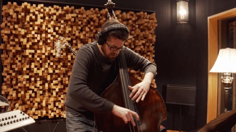 "Watch Bassist Jeff Denson Perform His New Single ""Listen Up"" With Romain Pilon & Brian Blade"