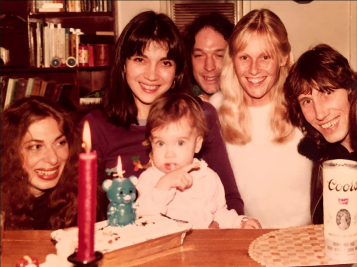 Eva celebrating her  first birthday with her family and Roger Waters of Pink Floyd