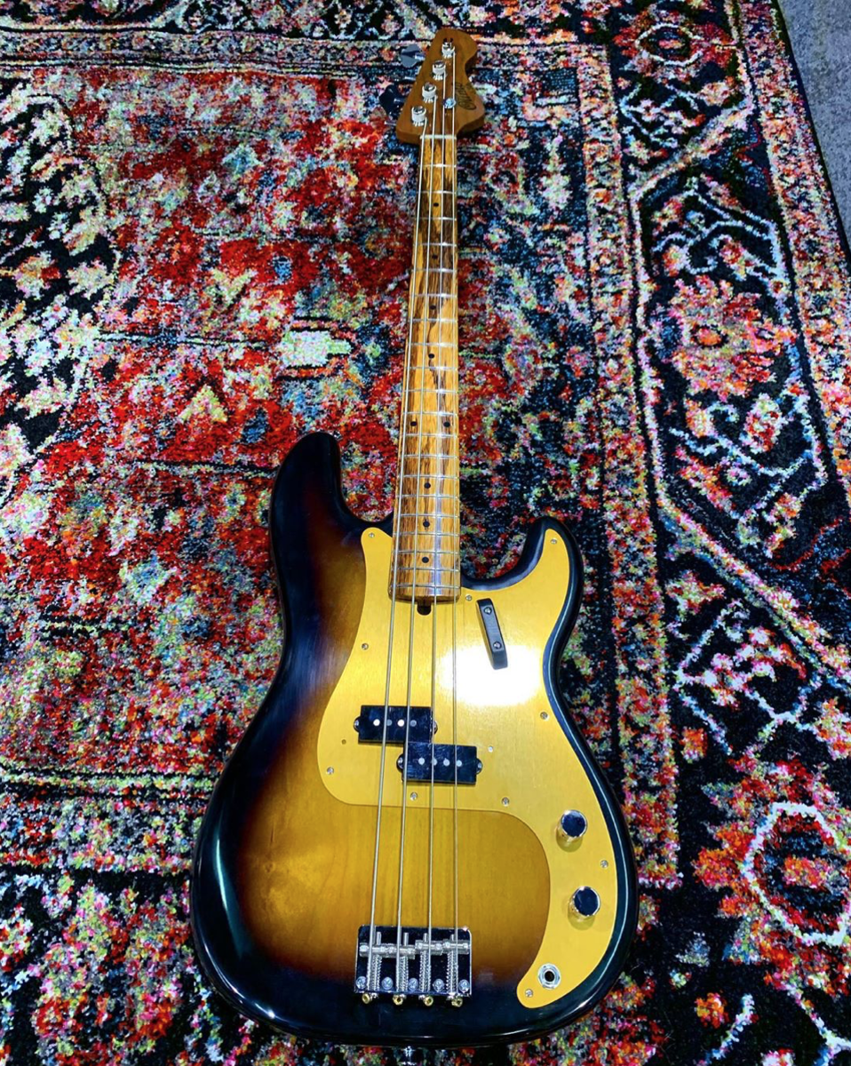 An Olinto P-Bass with a marblewood fingerboard.