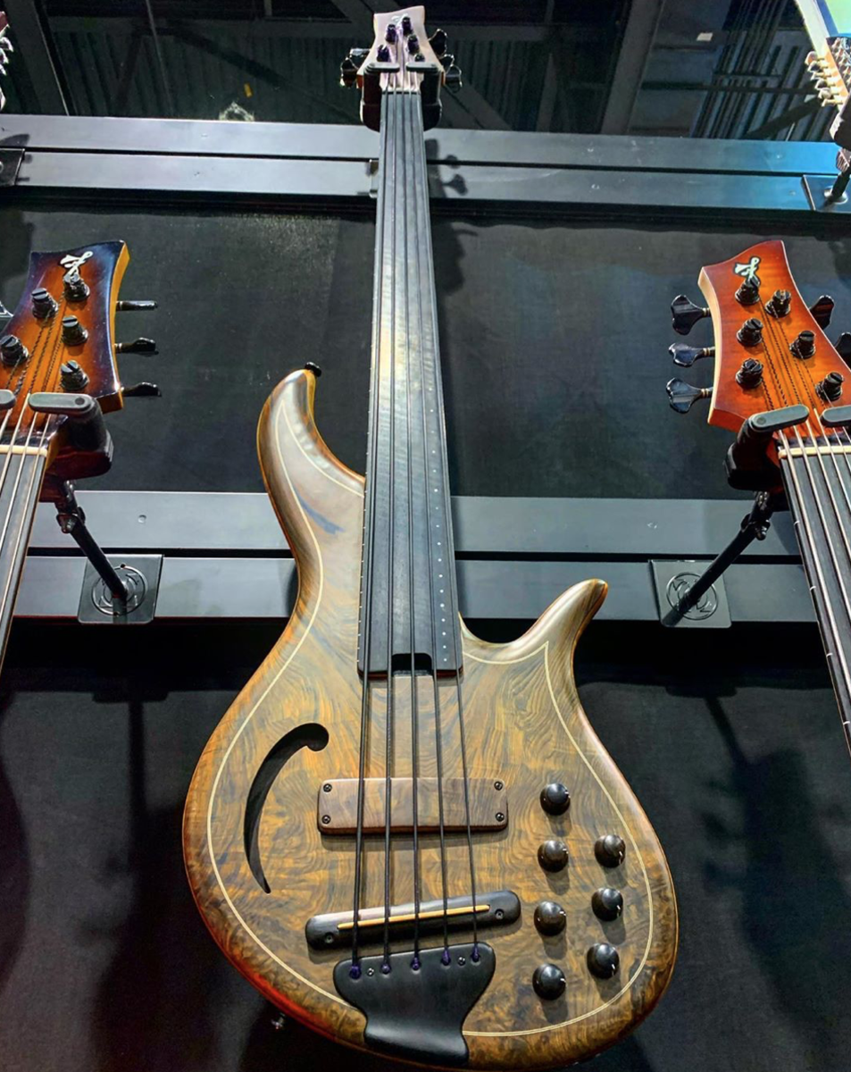 An F Bass AC5-Classic with a century old water-cured redwood top.